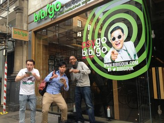 people eating Bibigo promotional food