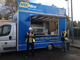HSS Hire branded catering van serving burgers for builders