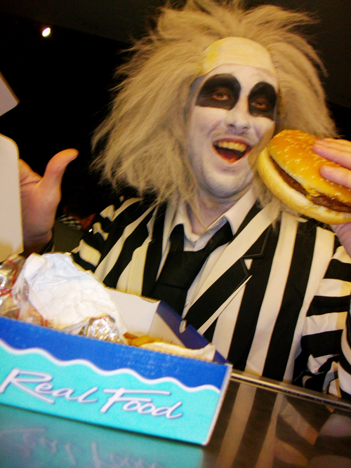 Chips and burger catering with Beetlejuice eating a burger